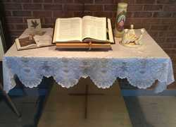 candle and bible on a table